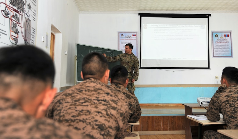 U.S. Air Force Master Sgt. Mark Hoover, 36th Contingency Response Support Squadron air advisor, shares his expertise on runway conditions during a subject-matter expert exchange, July 24, 2019 in Ulaanbaatar, Mongolia as part of Pacific Angel 2019.