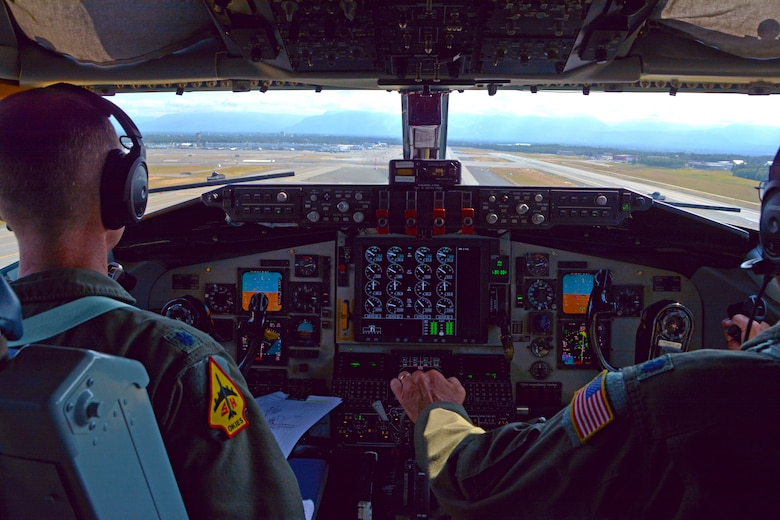 465th Air Refueling Squadron pilots, Lt. Cols. Marvin Ashbaker and Eric Wilks, guide a KC-1335R Stratotanker for landing on the runway at Ted Stevens Anchorage International Airport, Alaska, July 17, 2019. 507th Air Refueling Wing operations and maintenance Airmen were in Alaska supporting air refueling operations. (U.S. Air Force photo by Tech. Sgt. Samantha Mathison)