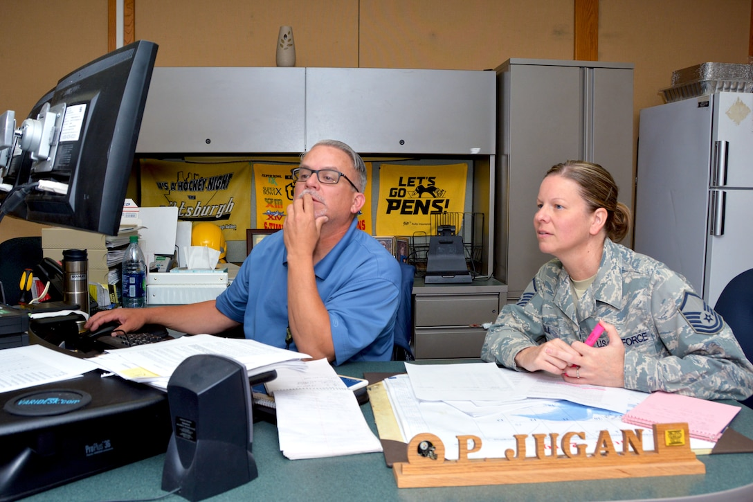 Master Sgt. Heather Bell, 507th Logistics Readiness Squadron Quality Assurance superintendent, goes over QA processes with Paul Jugan, 673rd Logistics Readiness Squadron Quality Assurance evaluator, July 18, 2019, at Joint Base Elmendorf-Richardson, Alaska. (U.S. Air Force photo by Tech. Sgt. Samantha Mathison)