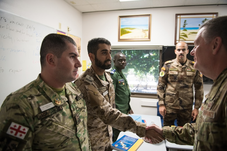 U.S. Air Force Lt. Gen. Brad Webb (right), commander of Air Education and Training Command (AETC), shakes hands with international students during his immersion tour at the 637th Training Group at Defense Language Institute English Language Center Aug. 1, 2019, at Joint Base San Antonio-Lackland, Texas.