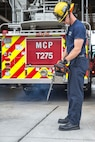 Jeremy Horton, a firefighter with the Marine Corps Base Camp Pendleton Fire Department, performs a function check on a chainsaw during the duty change over at MCB Camp Pendleton Fire Department Station Five on MCB Camp Pendleton, California, Aug. 1, 2019.  The MCB Camp Pendleton firefighters operate on 48-hour shifts, and spend the first morning of their shift assessing and cleaning vehicles and equipment to ensure mission readiness. The fire department has 11 stations on the installation and over 100 firefighters to act as first responders in the event of a fire or emergency.