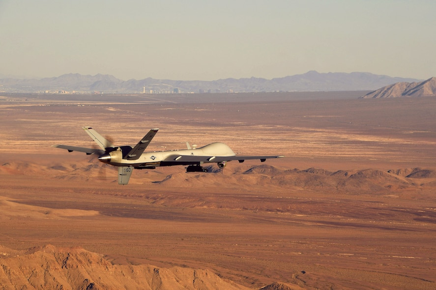 An MQ-9 Reaper flies a training mission over the Nevada Test and Training Range, July 15, 2019. The Reaper and its aircrew are considered one of the most demanded aircraft in combat operations due to its ability to provide oversight, gather intelligence and employ munitions on the battlefield for 18-20 hours at a time. (U.S. Air Force photo by Staff Sgt. James Thompson)