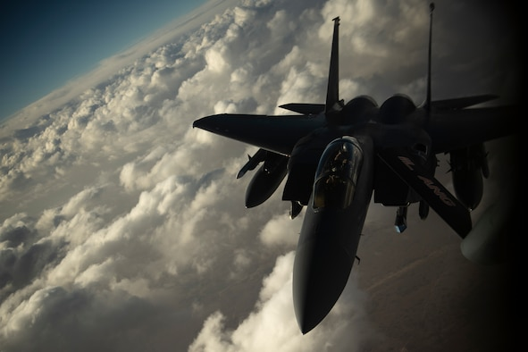 An F-15E Strike Eagle receives fuel from a KC-135 Stratotanker from the 28th Expeditionary Air Refueling Squadron, May 7, 2019, at an undisclosed location. The 28th EARS maintains constant presence in the U.S. Air Forces Central Command area of responsibility, supporting U.S. and Coalition aircraft in various operations conducted in countries such as Iraq, Syria, and Afghanistan. (U.S. Air Force photo by Master Sergeant Russ Scalf)