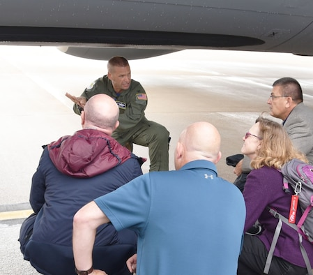 """Col. Phil Heseltine, 931st Air Refueling Wing commander, speaks with guests of a """"Bosslift"""" sponsored by the local Employer Support of the Guard and Reserve Aug. 3, 2019, at McConnell Air Force Base. During the event, ten civilian employers of 931 ARW Airmen received a first-hand look at how their Reservist employee supports strategic reach."""