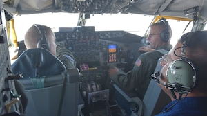 "(Left to right) Lt. Col. Joseph Oline, 931st Operations Support Squadron Mission Scheduling chief, and Col. Phil Heseltine, 931st Air Refueling Wing commander, fly a KC-135 Stratotanker assigned to McConnell Air Force Base, Aug. 3, 2019.  Jerry Lazar, Boeing KC-46 Pegasus Tanker Fleet chief, sat in the jump seat during the flight.  Lazar was one of ten civilian employers who participated in a ""Bosslift"" sponsored by the local Employer Support of the Guard and Reserve. During the event, civilian employers of 931 ARW Airmen received a first-hand look at how their Reservist employee supports strategic reach."