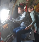 "(Left to right) Chris Hearne, Textron Aviation Senior Vice President of Engineering, and Cheryl Toms, Hearne's assistant, take pictures of an A-10 Thunderbolts from 442nd Fighter Wing at Whiteman AFB, Mo., during a ""Bosslift"" sponsored by the local Employer Support of the Guard and Reserve, Aug. 3, 2019.  The flight was also an example of how highly the 931 ARW values its relationships with their Reservists' employers, especially when it comes to the challenges associated with Reserve service."