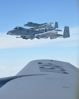 "Two A-10 Thunderbolts from the 442nd Fighter Wing at Whiteman AFB, Mo., flys close to the wing of a KC-135 Stratotanker assigned to McConnell Air Force Base, Kan., during a ""Bosslift"" sponsored by the local Employer Support of the Guard and Reserve, Aug. 3, 2019.  During the flight, 11 civilian employers of 931st Air Refueling Wing Traditional Reservists observed the aerial refueling of the A-10s by a 931 ARW aircrew."