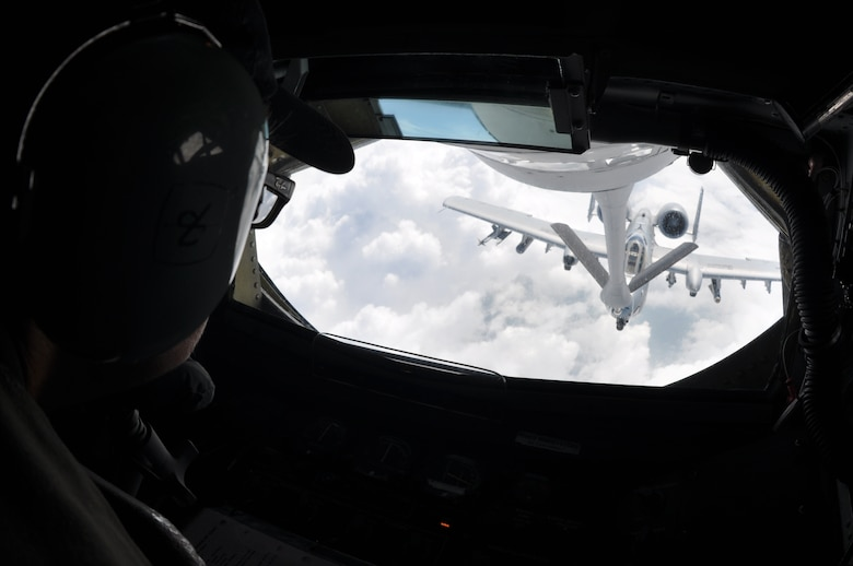 "Chief Master Sgt. Kathy Lowman, 18th Air Refueling Wing Squadron boom operator, refuels an -10 Thunderbolts from the 442nd Fighter Wing at Whiteman AFB, Mo., during a during a ""Bosslift"" sponsored by the local Employer Support of the Guard and Reserve, Aug. 3, 2019.  During the flight, ten civilian employers of 931st Air Refueling Wing Traditional Reservists observed the aerial refueling of the A-10s by a 931st Air Refueling Wing aircrew."