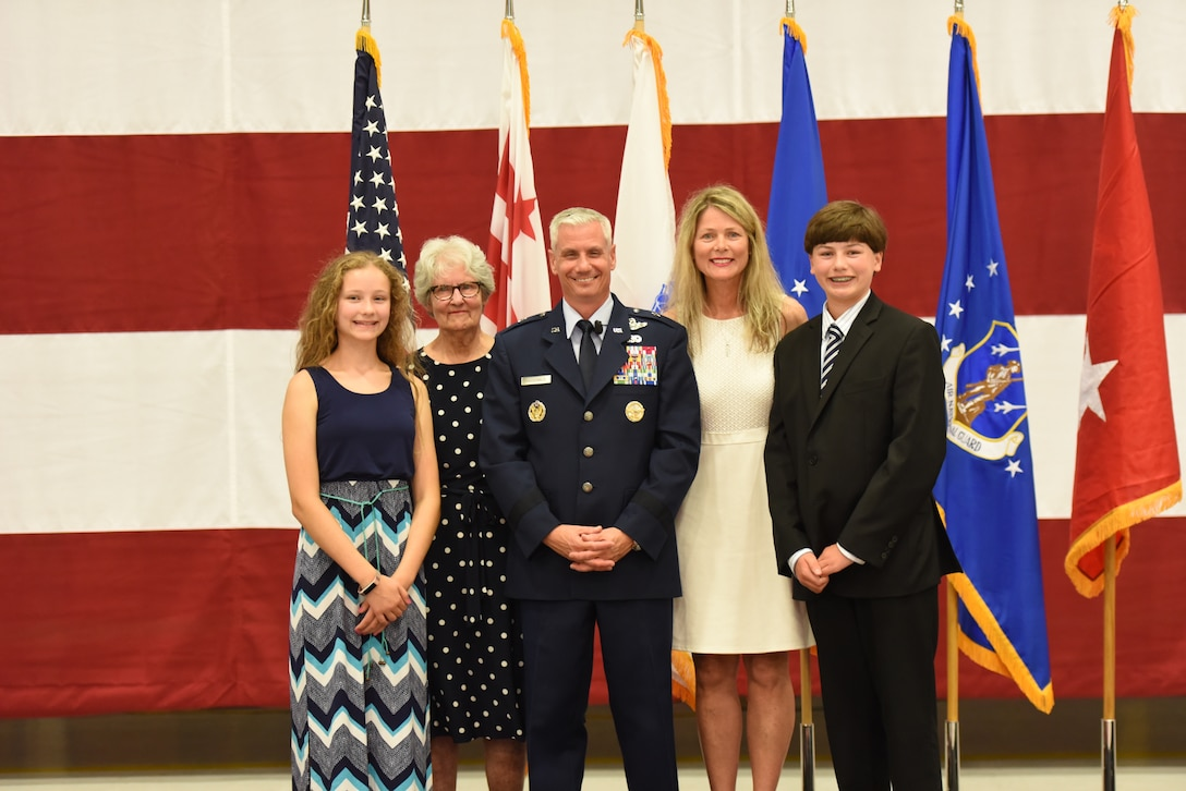 Brig. Gen. Keith G. MacDonald, commander, 113th Wing, District of Columbia National Guard, poses with his family after being promoted to brigadier general August 4, 2019 at Joint Base Andrews, Md. (Air National Guard photo by Senior Master Sgt. Craig Clapper)