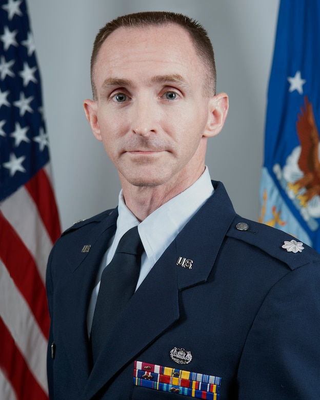 Lt. Col. Flannery, 434th Air Refueling Wing staff judge advocate, poses for an official portrait at Grissom Air Reserve Base, Ind.