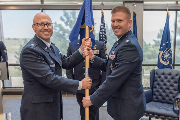Lt. Col. Speight Caroon assumed command of the 310th Operations Support Squadron during a ceremony July 14th, 2019. The 310th Operations Support Squadron provides support and applicable program oversight to the 310th and 710th Operations Groups space operations squadrons. They deliver mission qualification and instructor training, employment of weapons and tactics, actionable space intelligence and exercising the wing's space operations ability to meet Combat Air Force and Combatant Commands wartime requirements. (U.S. Air Force photo by Staff Sgt. Marko Salopek)
