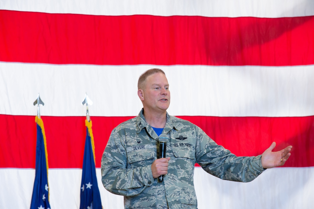 Col. James DeVere, the 302nd Airlift Wing commander, discusses the increase in suicides across the Air Force Reserve and asks wing members to take care of one another during a commander's call Aug. 3, 2019 at Peterson Air Force Base, Colorado. This commander's call was part of the 302nd AW's Resiliency Tactical Pause, which was directed by the Chief of Staff of the Air Force and also included resiliency breakout sessions and a family day picnic. (U.S. Air Force photo by Staff Sgt. Heather Heiney)