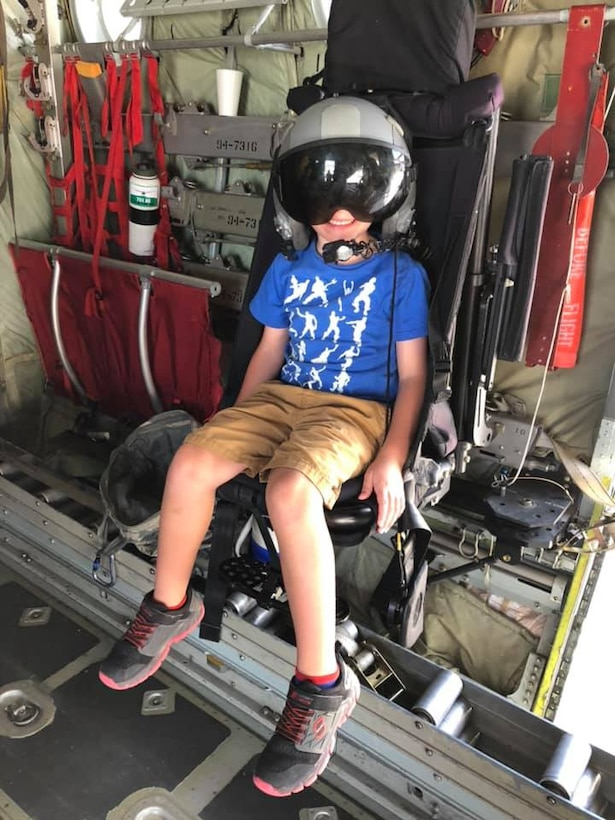 "Nathan Heiney, the son of Staff Sgts. Heather and Brian Heiney, 302nd Airlift Wing, tries on a flight helmet during the 302nd AW's family day ""Herc Adventure Tour,"" Aug. 3, 2019 at Peterson Air Force Base, Colorado. Family day was part of the 302nd AW's Resiliency Tactical Pause directed by the chief of staff of the Air Force to drive conversations about the importance of connectedness and help-seeking. (U.S. Air Force photo by Staff Sgt. Heather Heiney)"