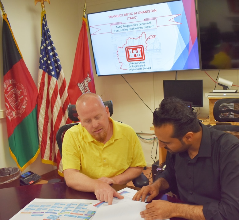 David Hardin, USACE TAAC Project Manager and TAAC Local National Lead Engineer discuss ongoing assessment of Afghan National Army and Afghan National Police at the Kabul Project Delivery Platform.