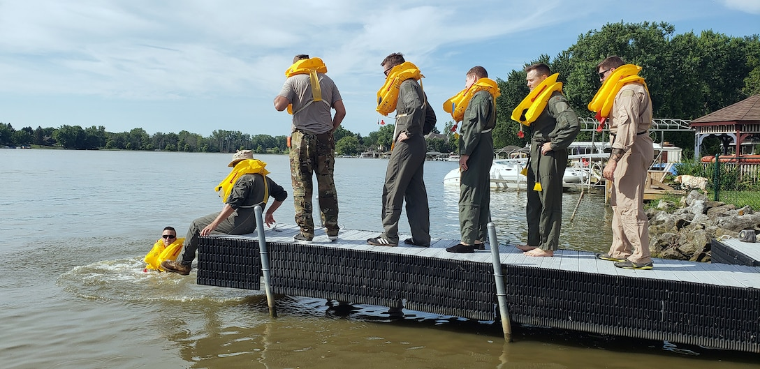 Reserve Citizen Airmen practice coordinated swimming techniques to stay warm and afloat during Survival, Evasion, Resistance and Escape training at Choctaw Lake in London, Ohio July 14, 2019