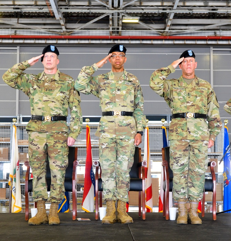 U.S. Army Reserve Command Deputy Commanding General Maj. Gen. A.C. Roper, center, salutes along with the incoming commander of the 377th Theater Sustainment Command, Maj. Gen. Greg Mosser, left, and outgoing commander, Maj. Gen. Steven Ainsworth, right,  during a change of command ceremony at Naval Air Station Joint Reserve Base New Orleans August 3, 2019.