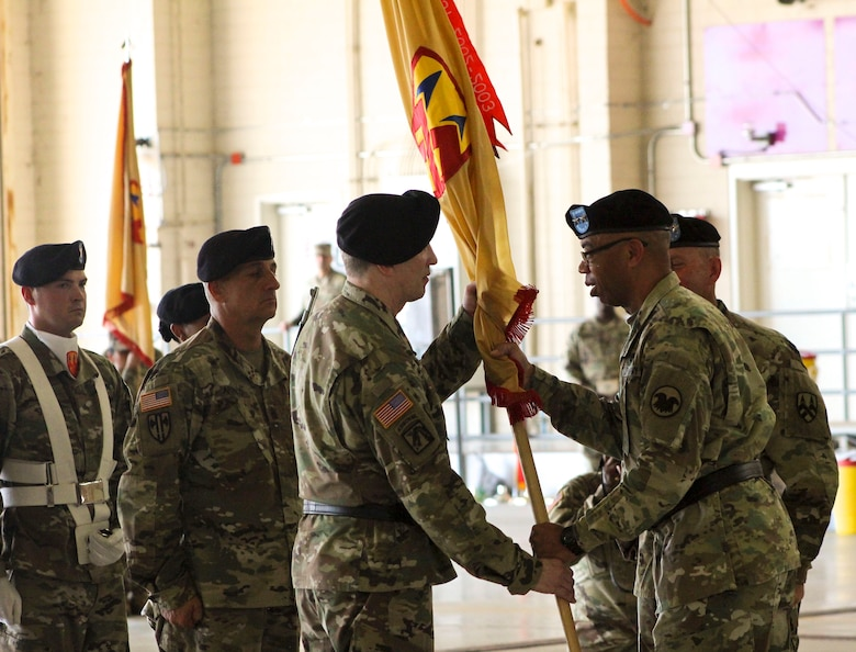 U.S. Army Reserve Command Deputy Commanding General, Maj. Gen. A.C. Roper, passes the 377th Theater Sustainment Command colors to Maj. Gen. Greg Mosser,  during a change of command ceremony at Naval Air Station Joint Reserve Base New Orleans, Belle Chasse, La.