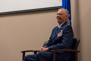 Lt. Col. Keith Gibson, 403rd Wing Operations Group deputy commander, laughs during his retirement ceremony Aug. 3, 2019 at Keesler Air Force Base, Mississippi. Throughout his tenure with the wing he had various positions such as the 815th Airlift Squadron's assistant director of operations, 53rd Weather Reconnaissance Squadron's director of operations, and 746th Expeditionary AS commander. (U.S. Air Force photo by Tech. Sgt. Christopher Carranza)