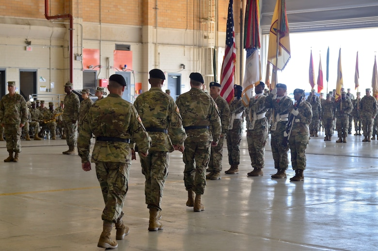 U.S. Army Reserve senior leaders walk to their places in preparation for the passing of the colors during the 377th Theater Sustainment Command change of command ceremony at Naval Air Station Joint Reserve Base New Orleans, Belle Chasse, La. August 3, 2019.