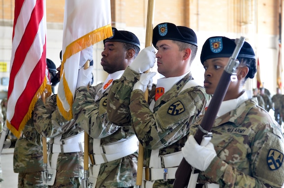 Members of the 377th Theater Sustainment Command color guard stand at attention during a change of command ceremony at NAS JRB New Orleans, Belle Chasse, La., August 3, 2019.