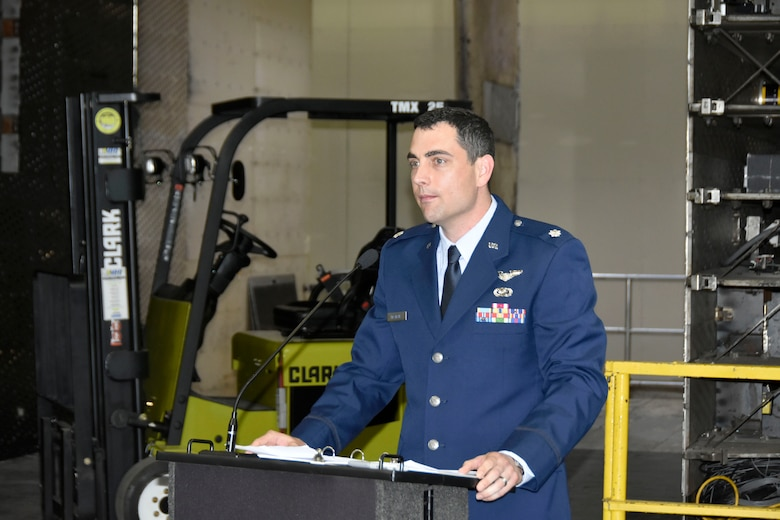 After accepting the guidon as the new AEDC Flight Systems Commander, Lt. Col. John McShane, addresses those in attendance at his Change of Leadership ceremony June 28. Before coming to Arnold, McShane previously served as Program Element Monitor for Advanced Aircraft Technology at the Directorate of Special Programs, Assistant Secretary of the Air Force at the Pentagon in Washington, D.C. (U.S. Air Force photo by Bradley Hicks)