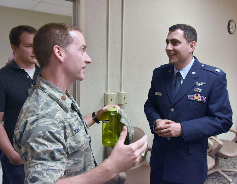 Following the Change of Leadership ceremony, AEDC Flight Systems Commander Lt. Col. John McShane, at right, is welcomed by Maj. Michael Knauf, AEDC Aeropropulsion Operations Officer, and other AEDC team members. (U.S. Air Force photo by Bradley Hicks) (This image has been altered by obscuring a badge for security purposes.)
