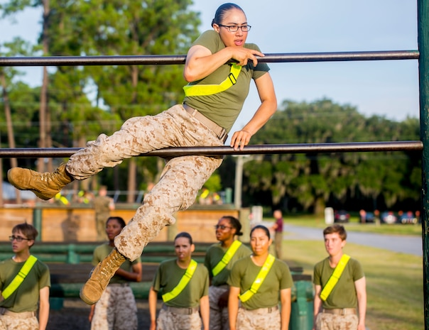 A recruit with Oscar Company, 4th Recruit Training Battalion, completes numerous challenges during the Obstacle Course on Marine Corps Recruit Depot Parris Island, S.C., July 26, 2019. This event is comprised of various obstacles and is designed to instill confidence in recruits by overcoming physical challenges. (U.S. Marine Corps photo by Lance Cpl. Dylan Walters)