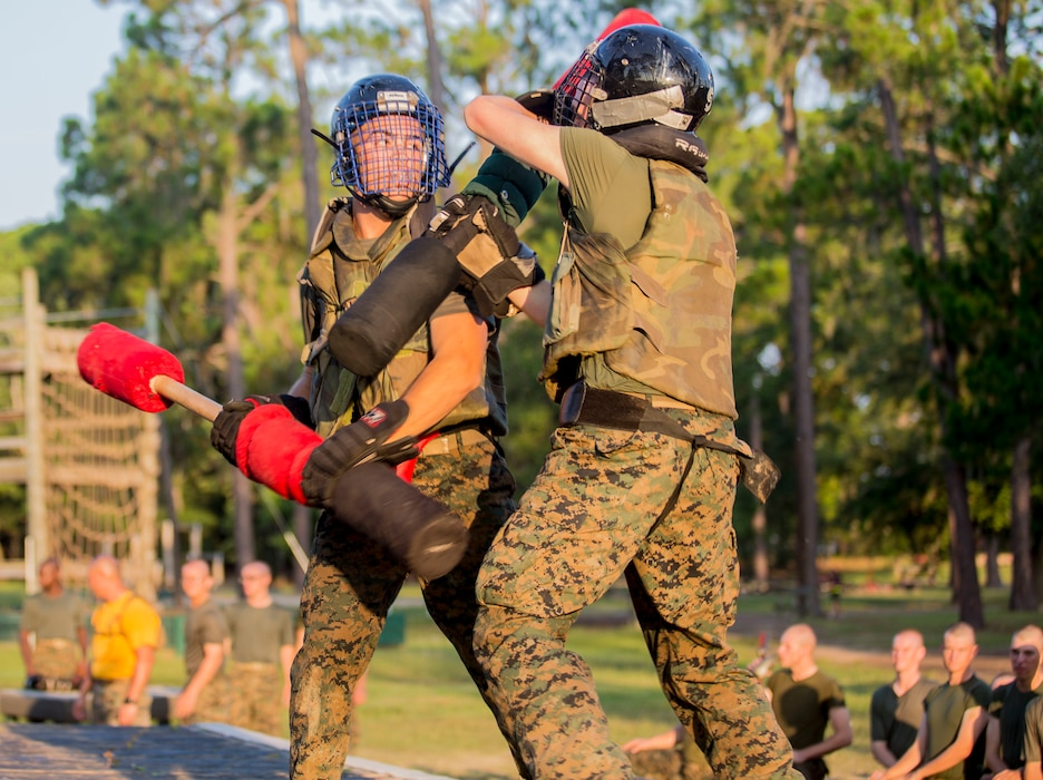 Recruits with Hotel Company, 2nd Recruit Training Battalion, engage pugil sticks at Marine Corps Recruit Depot Parris Island, S.C., July 31, 2019. Body sparring and pugil sticks help recruits apply the fundamentals of Marine Corps martial arts. (U.S. Marine Corps photo by Lance Cpl. Dylan Walters)