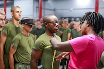 Recruits with Delta Company, 1st Recruit Training Battalion are measured by fitters before receiving their dress uniform issue July 31, 2019. (Photo by Gunnery Sgt. Tyler Hlavac)