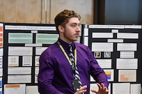 IMAGE: DAHLGREN, Va. (July 25, 2019) — A student briefs attendees on his technical project as his summer internship concluded at the Naval Surface Warfare Center Dahlgren Division. He was among 20 college students who completed their internships via the Naval Research Enterprise Internship Program (NREIP). The program encourages students to pursue science and engineering careers, furthers education via mentoring and their participation in research, and makes them aware of Navy research and technology efforts, which can lead to civilian employment within the Navy.