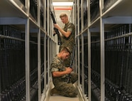 Marines who work at the armory perform weapons check on a weapons on Marine Corps Recruit Depot Parris Island S.C. June 21, 2019. The armory is in charge of over 10,000 rifles on Parris Island. (U.S. Marine Corps photo by Lance Cpl. Ryan Hageali)