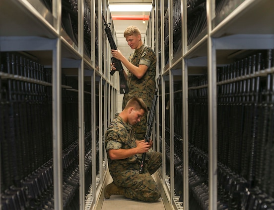 Marines who work at the armory perform weapons check on a weapons on Marine Corps Recruit Depot Parris Island S.C. June 21, 2019. The armory is in charge of over 10,000 rifles on Parris Island.