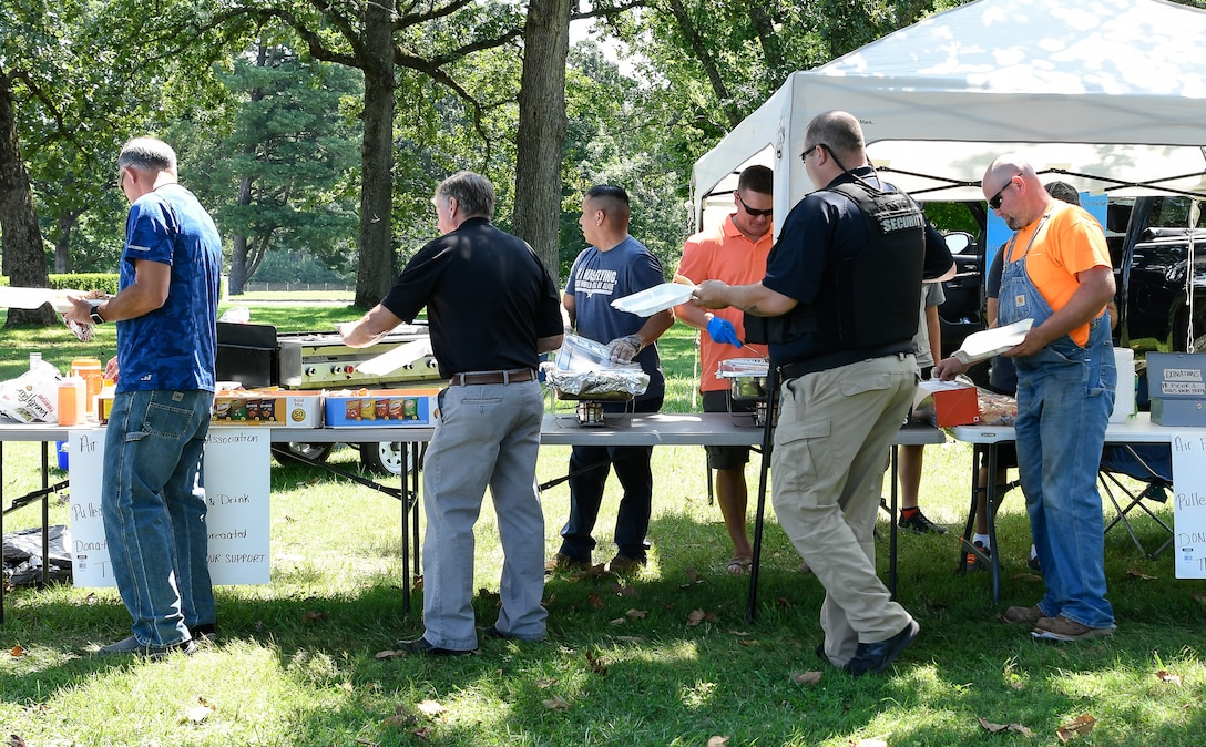Air Force Sergeant's Association Chapter 477 serves up pulled pork and sides July 26 during a joint event with the Arnold Air Force Base Junior Force Council at Arnold. Funds raised by the AFSA chapter are used to support community events such as the Military Appreciation Day and the AEDC Children's Christmas Party. (U.S. Air Force photo by Jill Pickett)