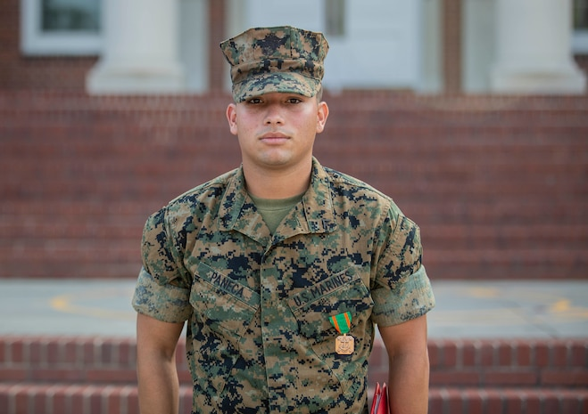 Lance Cpl. Angel Paneca is awarded a Navy and Marine Corps Achievement Medal by Headquarters and Service Battalion Commanding Officer Col. Sean C. Kileen at an awards ceremony on Parris Island, S.C. Aug. 1st, 2019. 