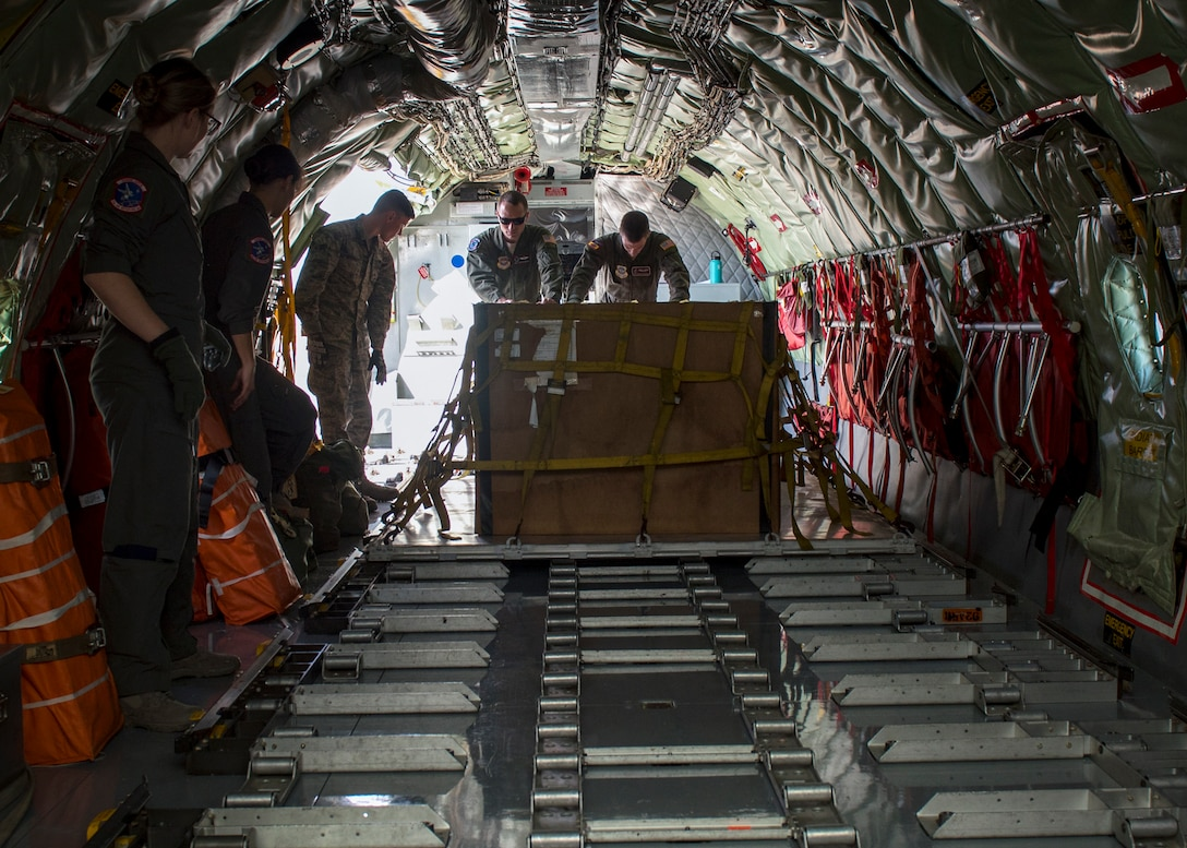 Aircrew load cargo onto a KC-135 Stratotanker during a cargo load training at Fairchild Air Force Base, Washington, Oct. 17, 2018. (U.S. Air Force photo/Airman 1st Class Whitney Laine)