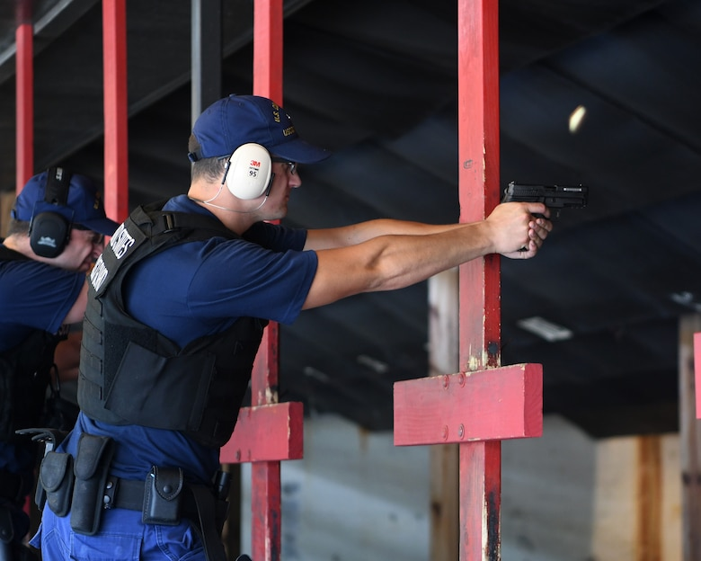 A U.S. Coast Guard gunner's mate from USCG Cutter Hamilton participates in annual combat arms training at Joint Base Charleston, S.C., Aug. 1, 2019. Coast Guard combat arms instructors from U.S. Coast Guard Sector Charleston assisted in the evaluation of the guardsmen to ensure they were ready and worldwide qualified for their next mission. Combat Arms Training and Maintenance instructors support the readiness of Joint Base Charleston's mission partners through training and evaluating service members on proficiently operating and safely handling their weapons. The partnership between Air Force and Coast Guard personnel supports USCG Sector Charleston in their mission of performing maritime safety, security and stewardship in their area of responsibility.