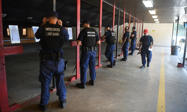 U.S. Coast Guardsmen from USCG Cutter Hamilton receive their pre-training safety brief before taking part in annual combat arms training at Joint Base Charleston, S.C., Aug. 1, 2019. Coast Guard combat arms instructors from U.S. Coast Guard Sector Charleston assisted in the evaluation of the guardsmen to ensure they were ready and worldwide qualified for their next mission. Combat Arms Training and Maintenance instructors support the readiness of Joint Base Charleston's mission partners through training and evaluating service members on proficiently operating and safely handling their weapons. The partnership between Air Force and Coast Guard personnel supports USCG Sector Charleston in their mission of performing maritime safety, security and stewardship in their area of responsibility.