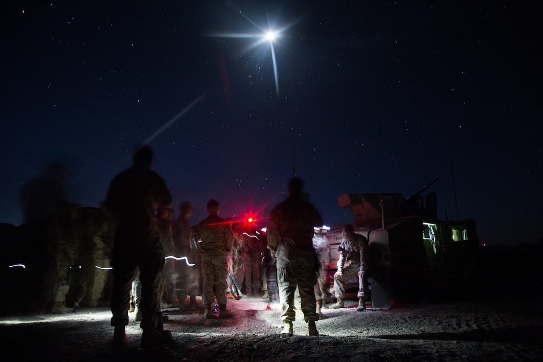 U.S. Marines and Sailors assigned to Marine Wing Support Squadron 272 prepare for an early morning brief during Integrated Training Exercise 5-19 at Marine Corps Air Ground Combat Center, Twenty-nine Palms, California, July 27, 2019. ITX 5-19 is a large-scale, combined-arms training exercise that produces combat-ready forces capable of operating as an integrated Marine Air-Ground Task Force.