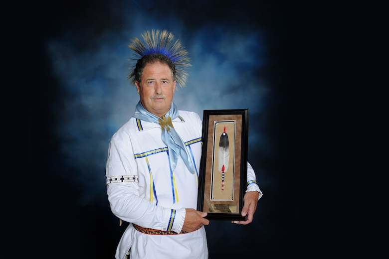 Edward Blauvelt poses in his American Indian regalia for a photo at the 502nd Air Base Wing public affairs office. Blauvelt was recently presented the 2019 Society of American Indians Government Employees Meritorious Service Award. (U.S. Air Force photo by Melissa Peterson)