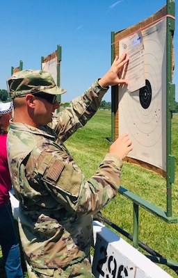 Lt. Col. Jason Harris looks at his target during the National Matches at Camp Perry, July 2019. The month-long national shooting festival hosts more than 6,000 military and civilian participants who train and compete in a variety of competition including traditional pistol, smallbore, high-power rifle and long-range rifle.