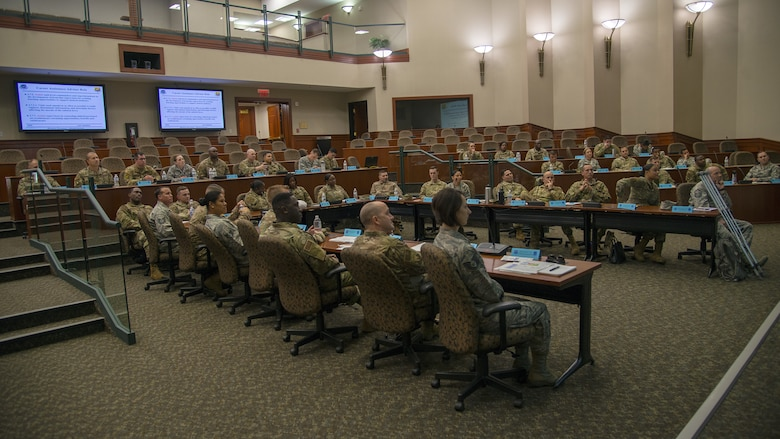 Students listen to a lecture during the SNCO Professional Enhancement Seminar at MacDill Air Force Base, Fla., Aug. 2, 2019. This professional enhancement seminar is a week-long, discussion-led training course that prepares Airmen for their new SNCO responsibilities.