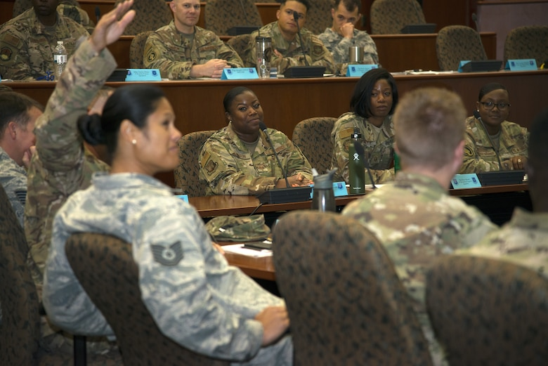 U.S. Air Force Tech. Sgt. Katrina Johnson, 6th Mission Support Group resource advisor, and surrounding students listen to a fellow Master Sgt. select during the SNCO Professional Enhancement Seminar at MacDill Air Force Base, Fla., Aug. 2, 2019.  This professional enhancement seminar is a week-long, discussion-led training course that prepares Airmen for their new SNCO responsibilities.
