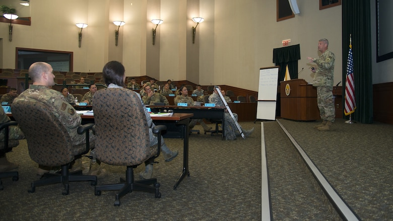U.S. Air Force Capt. Jeremy Guy, 6th Air Mobility Wing executive officer, briefs students on resource management during the SNCO Professional Enhancement Seminar at MacDill Air Force Base, Fla., Aug. 2, 2019. This professional enhancement seminar had multiple subject matter experts and panels explain the responsibilities and expectations of a SNCO.