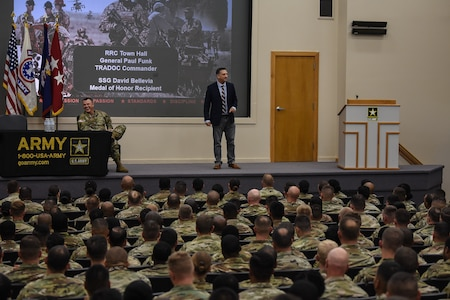 Medal of Honor Recipient Staff Sgt. David Bellavia shares with students of the U.S. Army Recruiting and Retention College the value of what they do for the Army during a presentation at Hazard Auditorium on Fort knox, Kentucky, July 31. He emphasized how important recruiting is in making the Army the best it's ever been with the next generation of Soldiers and leaders. Bellavia was accompanied by Gen. Paul Funk II, commanding general of U.S. Army Training and Doctrine Command. (U.S. Army photo by Lara Poirrier)