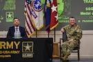 Medal of Honor Recipient Staff Sgt. David Bellavia (left) and Gen. Paul Funk II, commanding general of U.S. Army Training and Doctrine Command (right), answer questions from U.S. Army Recruiting and Retention College students at Hazard Auditorium, Fort Knox, Kentucky July 31. Funk opened the floor to questions following a motivational speech given by Bellavia about the importance of recruiting. (U.S. Army Photo by Lara Poirrier)