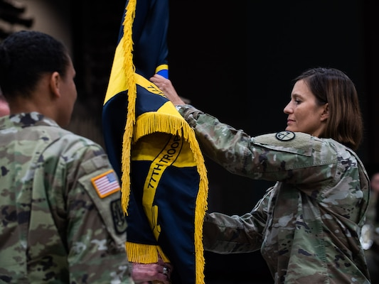 Col. Michaelle Munger relinquishes command to Lt. Col. Tanya McGonegal Aug. 3, 2019, during a formal change of command ceremony for the 77th Brigade. McGonegal is the first female African American brigade commander and Munger was the first female brigade commander in the WVARNG's history. (U.S. Army National Guard photo by Sgt. Davis Rohrer)