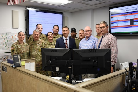 Medal of Honor Recipient Staff Sgt. David Bellavia stops for a photo with the Soldiers and staff of the U.S. Army Recruiting Command Recruiting Operations Center during a visit to USAREC headquarters at Fort Knox, Kentucky, July 31. Bellavia came to Fort Knox to learn about and show his support for the Army accessions mission and this was his first visit to the command. (U.S. Army Photo by Laura Poirrier)