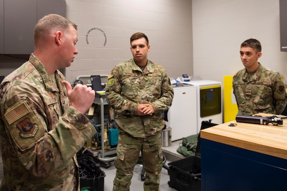 Ninth Air Force Command Chief Master Sgt. Benjamin W. Hedden, speaks to two aircrew flight equipment (AFE) Airmen from the 41st Rescue Squadron at Moody Air Force Base (AFB), Ga., July 30, 2019. During the visit, Hedden discussed the quality of life of Airmen living assigned to Moody AFB. (U.S. Air Force photo by Airman Azaria E. Foster)
