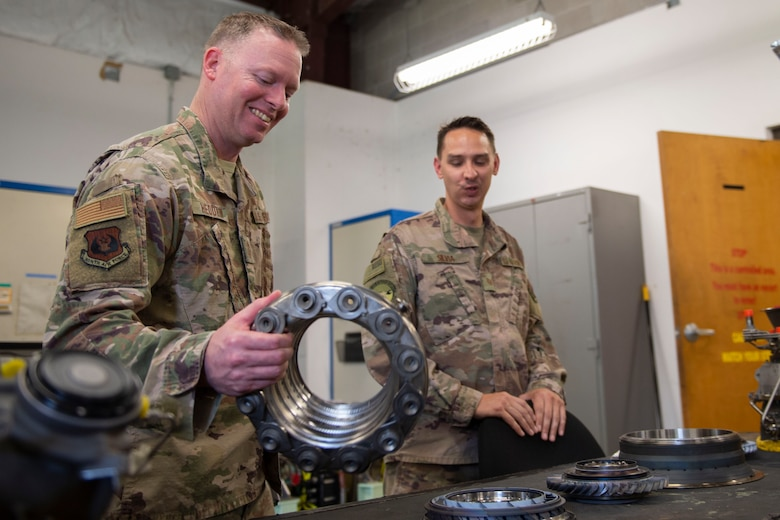 Ninth Air Force Command Chief Master Sgt. Benjamin W. Hedden, holds an engine combustion liner at Moody Air Force Base, Ga., July 30, 2019. The 41st Helicopter Maintenance Unit keeps HH-60G Pave Hawk's operationally ready by performing inspections and repairs on various components of the helicopter. (U.S. Air Force photo by Airman Azaria E. Foster)