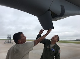 (Left to right) Master Sgt. Jesse Fuller, 931st Aircraft Maintenance Squadron crew chief, and Lt. Col. Joseph Oline, 931st Operations Support Squadron Scheduling chief and KC-135 Stratotanker pilot, perform a pre-flight check Aug. 3, 2019, at McConnell Air Force Base. The inspection being performed on a KC-135 is accomplished on a regular schedule in order keep the aircraft mission ready.